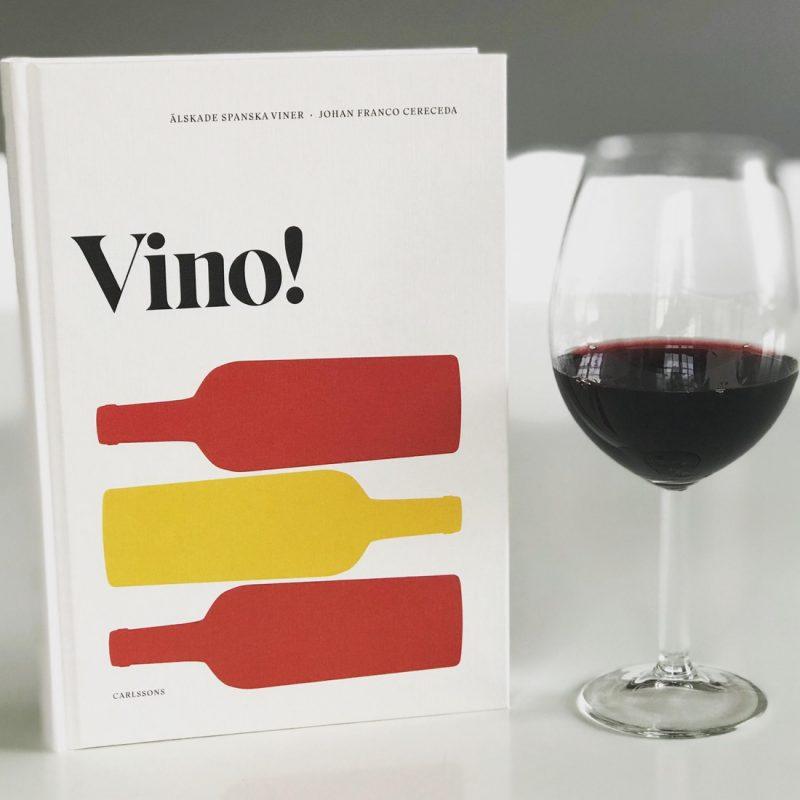 Boken Vino samt ett halvfyllt vinglas